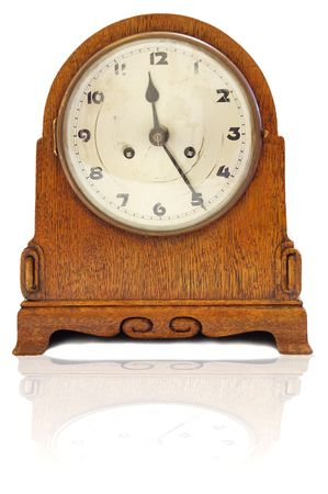 old clock isolated on a white background