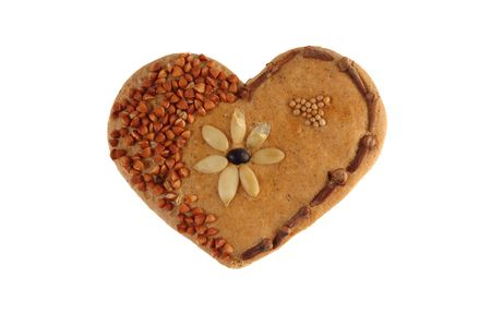 Lovely heart, made of bread, grits, seeds and clove. Stock Photo - 2501691