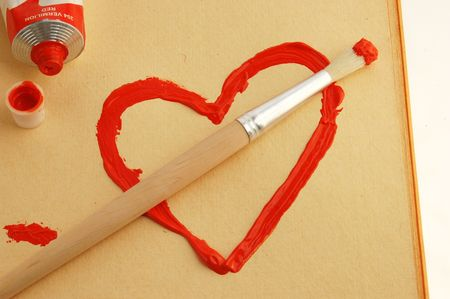Painted red heart with brush.  photo