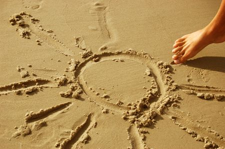 Sun drawn on sany beach. Vacations and summer concept