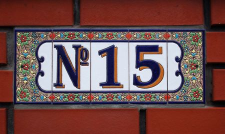 House number tile plaque with floral ornament.  Stock Photo