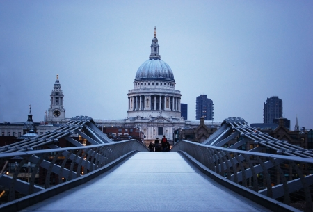 St Pauls Cathedral and Millennium Bridge in London at evening.  photo