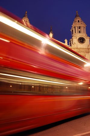 Blurred red London bus. St Pauls Cathedral in background photo