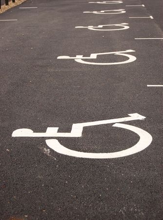 Parking place for handicapped. Sign painted on asphalt Stock Photo - 3176128