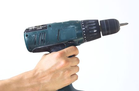 Hand holding cordless drill over white background photo