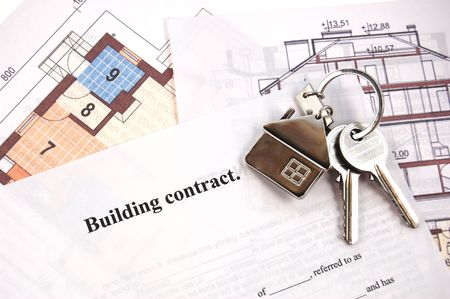 Keys on building contract and blueprints Stock Photo