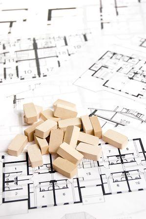 Bricks over blueprint. Real estate concept Stock Photo - 3876665