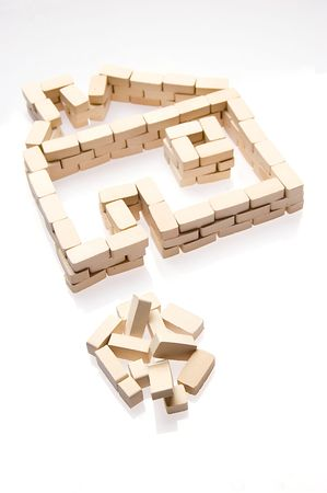 House symbol and bricks over white. Real estate icon Stock Photo - 3876662