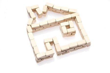 House symbol and bricks over white. Real estate icon Stock Photo
