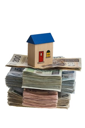 Real estate concept - House on stack of polish zlotys isolated Stock Photo - 4103421