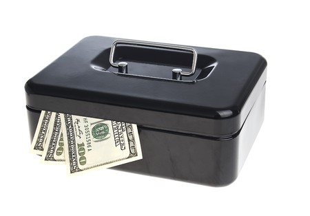 Dollars in black cash box isolated on white photo