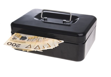 polish zlotys in black cash box isolated on white photo