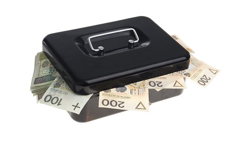 polish zlotys in black cash box isolated on white