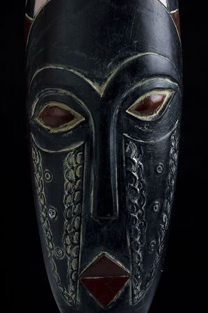 African mask over black background with copy space Stock Photo - 4839859