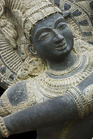 krishna: Stone Krishna Shiva statue. Object of cult in hindu culture.