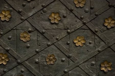 steel monastery door texture with flowers ornament photo