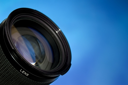 Photograpy lens over abstract blue background. photo