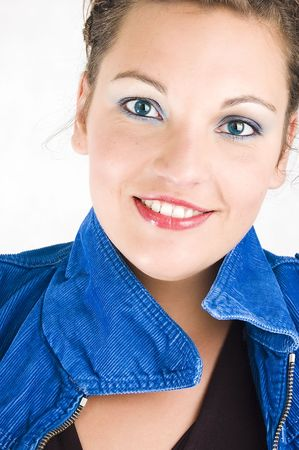 Portrait of beautiful young woman with blue eyes. photo