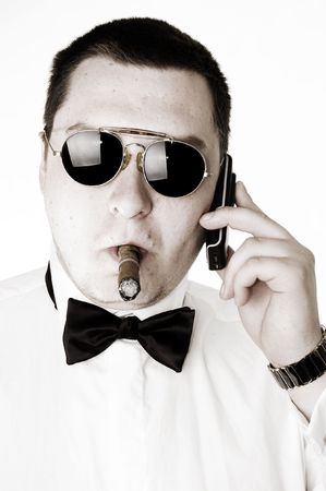 Macho man with cigar and sunglasses talking on cellphone Stock Photo - 5834976