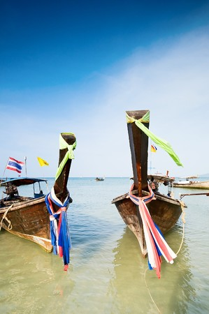railey: Tradiotional Thailands longtail boats on Railey beach. Stock Photo