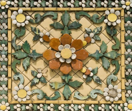 Old floral, ceramic tile in Grand Palace, Thailand photo