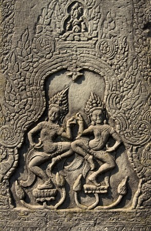 Ancient stone relief in Angkor Wat, Cambodia photo