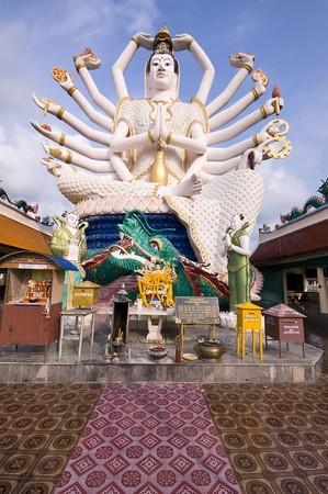koh: Eighteen arms Buddha over blue sky, Koh Samui. Thailand Stock Photo