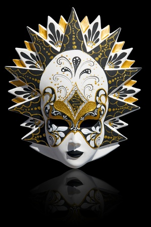 Gold traditional venetian carnival mask isolated on black. Venice, Italy. photo
