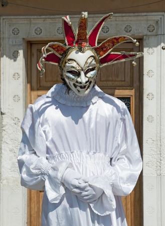 VENICE, ITALY - APRIL 10, 2011, unidentified masked person in traditional venetian costume.