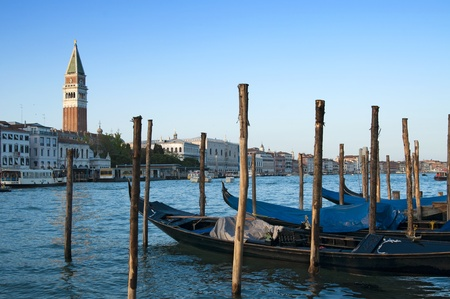 Traditional venetian gondlolas and St Mark Stock Photo - 10110077