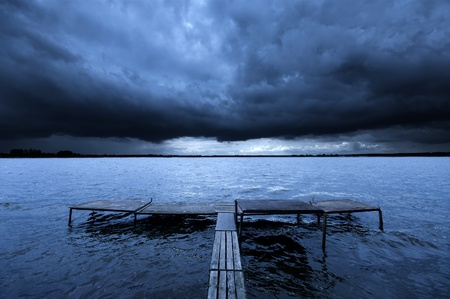 old pier: Old pier over dramatic story clouds. Zalew Zegrzynski, Poland. Stock Photo
