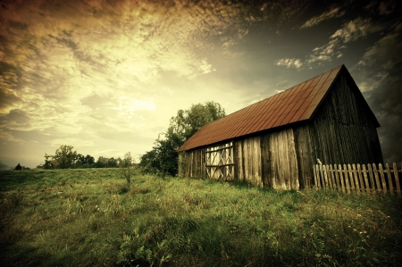 Old wooden bar with red roof over the dramatic sunset. Zalew Zegrzynski, Poland Stock Photo