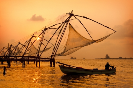 chinese fishing nets: Sunset over Chinese Fishing nets and boat in Cochin  Kochi , Kerala, India