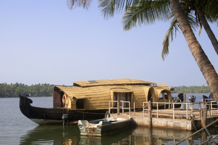 A parked houseboat on the backwaters of Kerala, India  photo