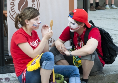 WARSAW, POLAND - JUNE 16: Russian fans make face painting before football match with Greece on July 16, 2012 in Warsaw, Poland. Uefa Euro 2012 is hosted by Poland and Ukraine. Stock Photo - 14144001