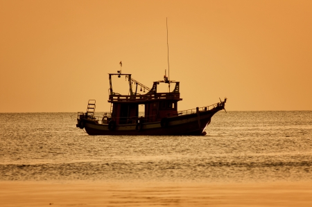Sunset with  boat on tropical beach. Ko Tao island, Thailand photo