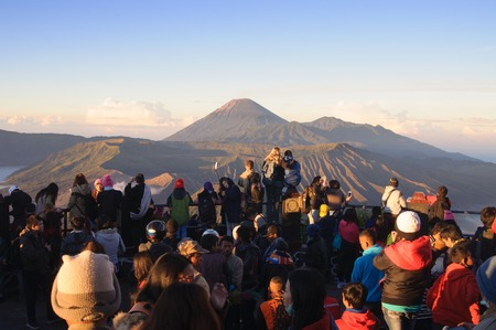 tengger: Tourists watching sunrise over the Bromo volcano Tengger Semeru National Park in East Java Indonesia on June 26 2014 Editorial