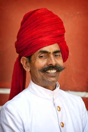 maharaja: Smiling man with mustache styles as maharaja in City Palace in Jaipur India. April 01 2012 Editorial