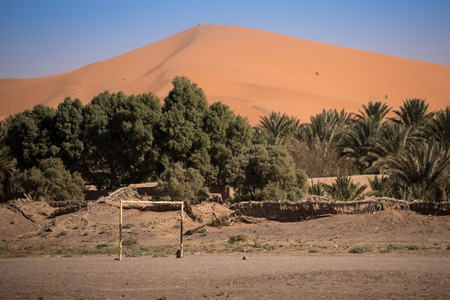 erg: Village garden and football field in Hassilabied, Erg Chebbi, Sahara Desert, Moroco