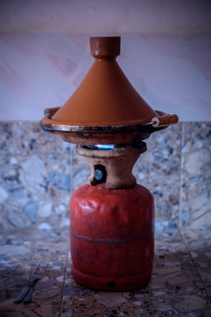 Traditional moroccan tajine making on gas bottle in the village