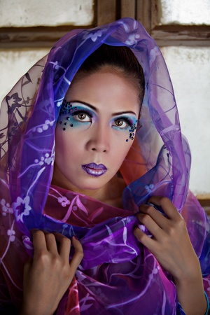 Young Beautiful Asian Woman Wearing a Colorful Veil