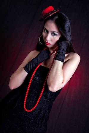 Portrait of Attractive Asian Woman with Red Necklace, Hat and Black Gloves