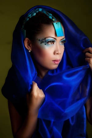 Young Beautiful Asian Woman in a Blue Veil