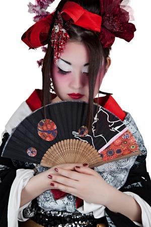 Beautiful Asian Woman Wearing a Japanese Outfit Holding a Folding Fan photo