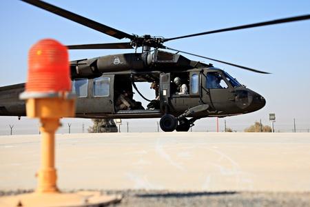 blackhawk helicopter: KUWAIT - JANUARY 19, 2011: U.S. Blackhawk SH-60 prepares to take off for a training exercise January 19, 2011 in Kuwait.