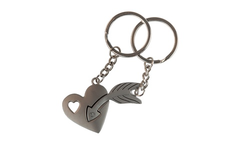 Gift Keychain in a Heart and Arrow Shape Isolated on White Background Stock Photo
