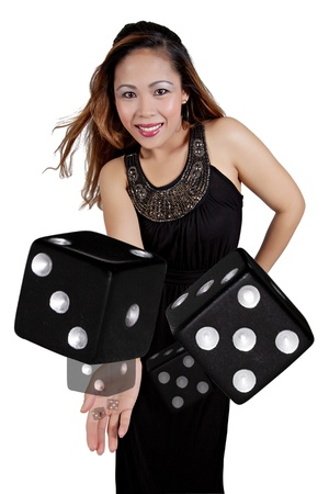 Asian Female Tossing a Pair of Black Dice