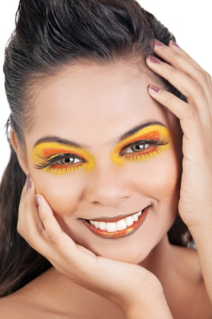 Close up of an Asian Females Face Wearing Orange and Yellow Makeup