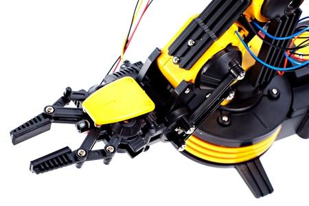 Closeup Black and Yellow Robotic Arm photo