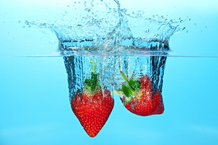 Strawberries Dropped in Water Causing a Splash